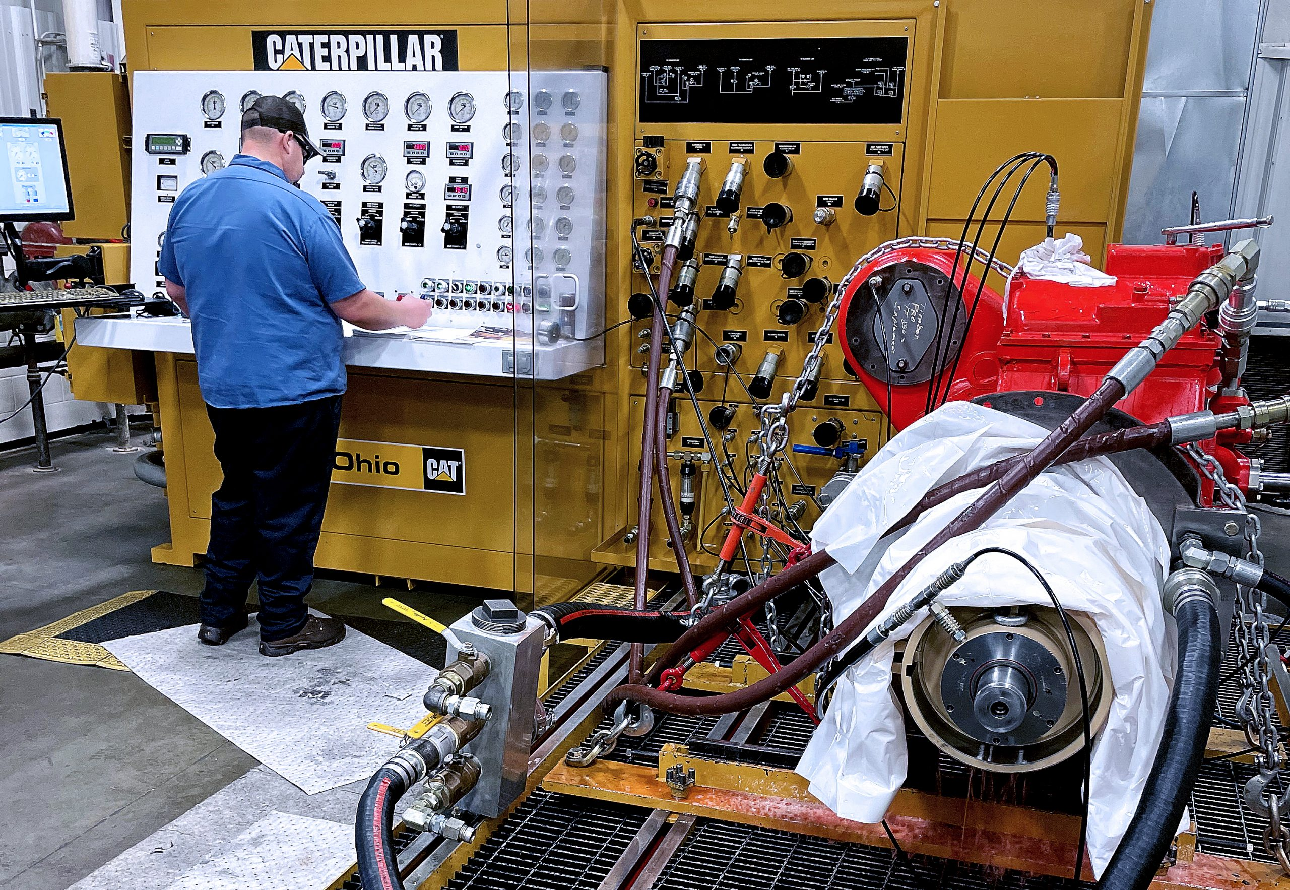 complete employee in the process of testing a cylinder