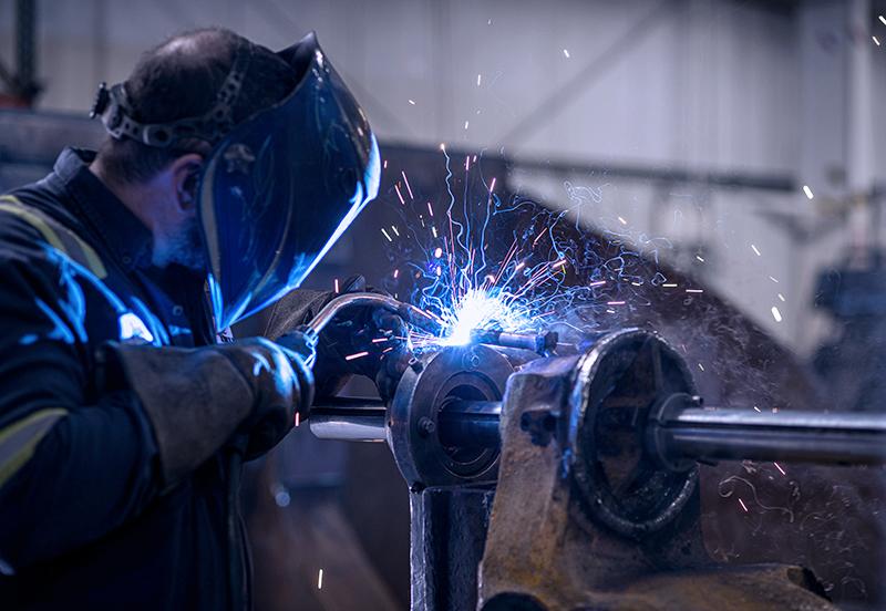Welder with welding mask on